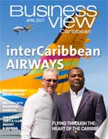 April, 2017 Issue cover for Business View Caribbeam. Two men are standing in front of the tail of an airplane.