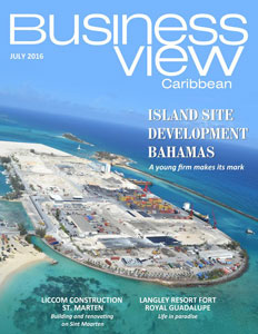 Business View Caribbean's July 2016 issue with an aerial photo of an island with blue water and sky in view.