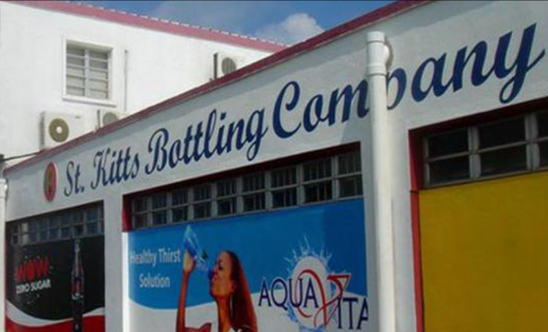 The front of a St. Kitts Bottling Company building.