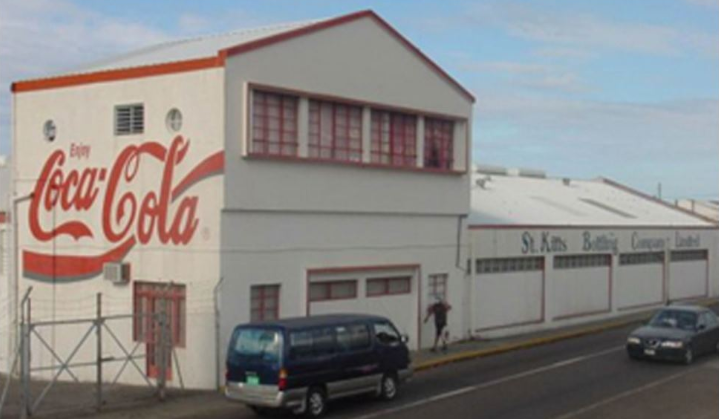 Street view of St. Kitts Bottling Company building with Coca Cola on the side.