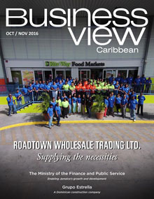 Business View Caribbean October 2016 cover featuring Roadtown Wholesale Trading Ltd. with a photo of employees standing at the front of a building.