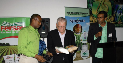 The Honorable Karl Samuda, Minister to the Ministry of Industry, Commerce, Agriculture and Fisheries Jamaica meets with business people at a conference.