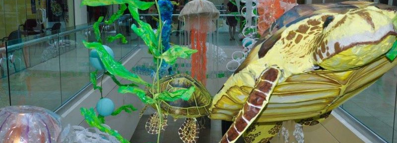 Underwater hanging art display at the Sheraton Mall, showing turtles, jelly fish, seaweed and more.