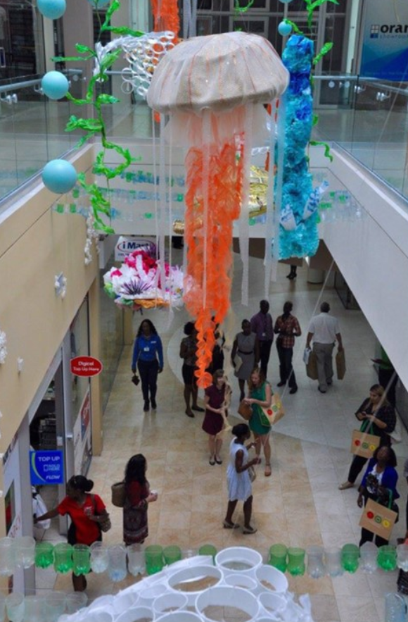 A second story view of a handing underwater display art at the Sheraton Mall.