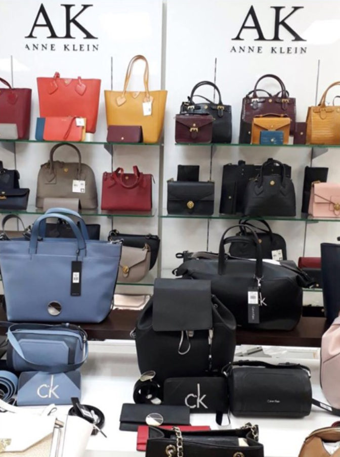 An assortment of Anne Klein handbags on display at a store in the Sheraton Mall mall.
