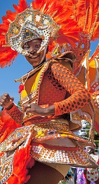 Bahamas Mortgage Corporation. A dancer dressed up in a colorful costume.