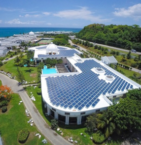 Sofos Jamaica. Aerial view of a large building with solar panels.