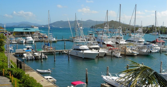 A view of large boats and sailboats docked in St. Thomas