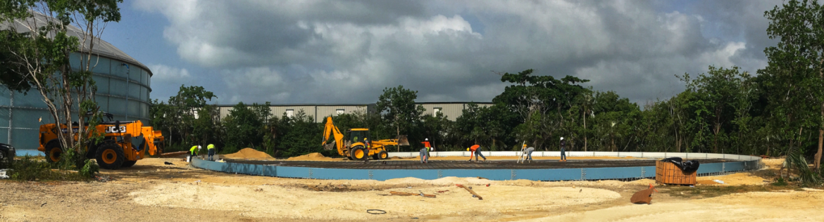 A water authority Cayman construction site with excavators and employees at work.