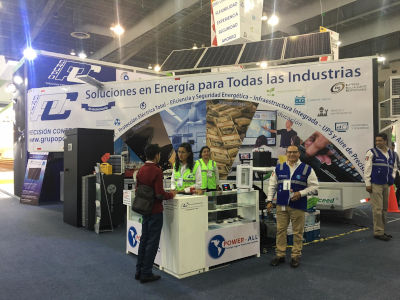 Grupo Precision Control at a conference with their booth set up and people present.
