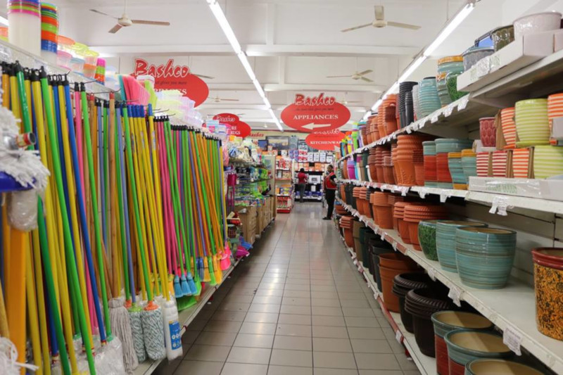 Bashco Trading Company isle showing cleaning supplies on the left and pots for plants on the right.