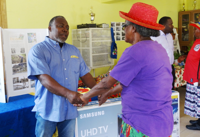 Michael Thomas Donating TV to Elders. Clarence Thomas Limited Home Center / CTL Home Center.
