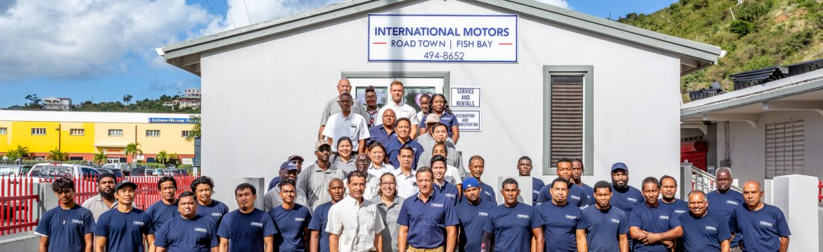 International Motors BVI / British Virgin Islands group photos of staff in front of their building.