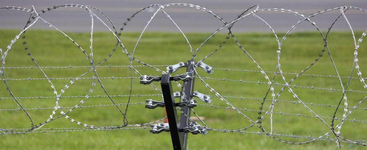 A fence with razor wire on top. New Study Shows how Trinidad and Tobago can Prevent Crimes with Innovative Approach