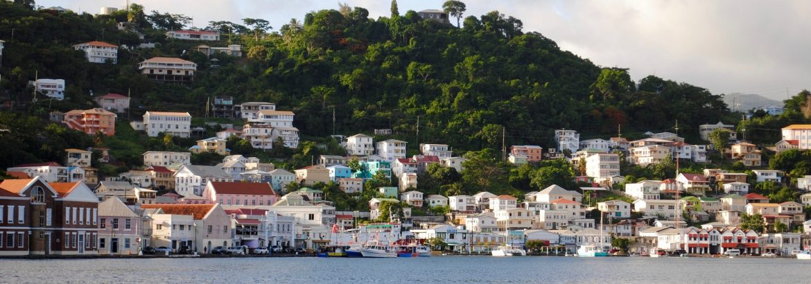 Island of Grenada from the water looking at houses along the shore.