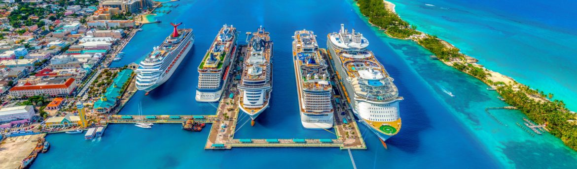 A row of cruise ships at a port in Nassau Bahamas.
