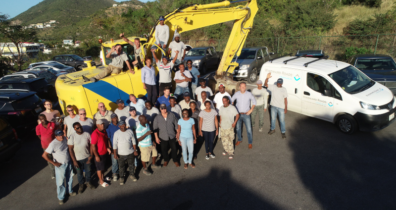 Winward Roads Infrastructure group photo of employees on and around an excavator.