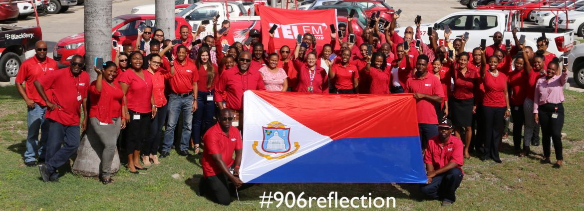 TelEm Group Sint Maarten group photo with #906 reflection printed on it.