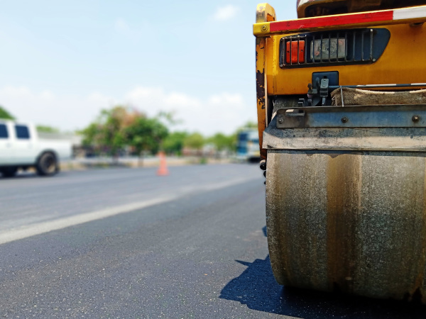 Virgin Islands Paving Inc. stock image of a steam roller working on a road.
