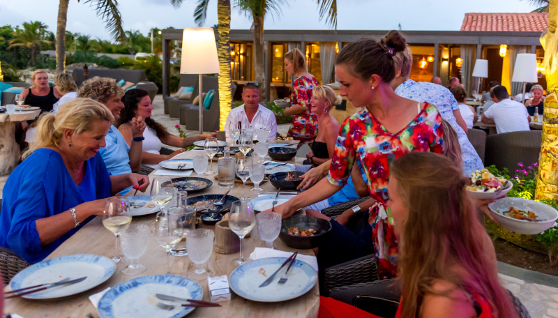 Delfins Beach Resort, brace the roast dinner at a table outside.