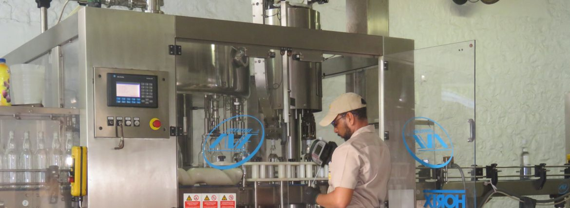 St. Vincent Distillers Limited employee testing production on equipment.