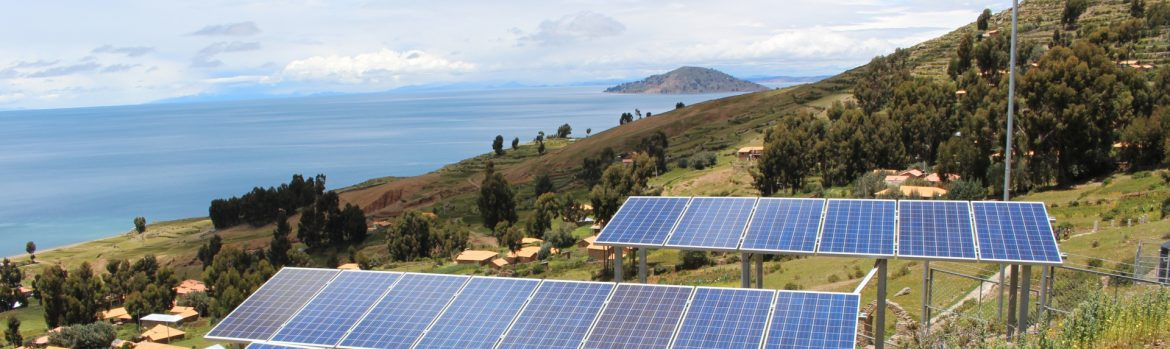 Jamaica Government Expanding Energy Sector To Generate More Jobs. Photo of solar panels on a Caribbean island hillside.