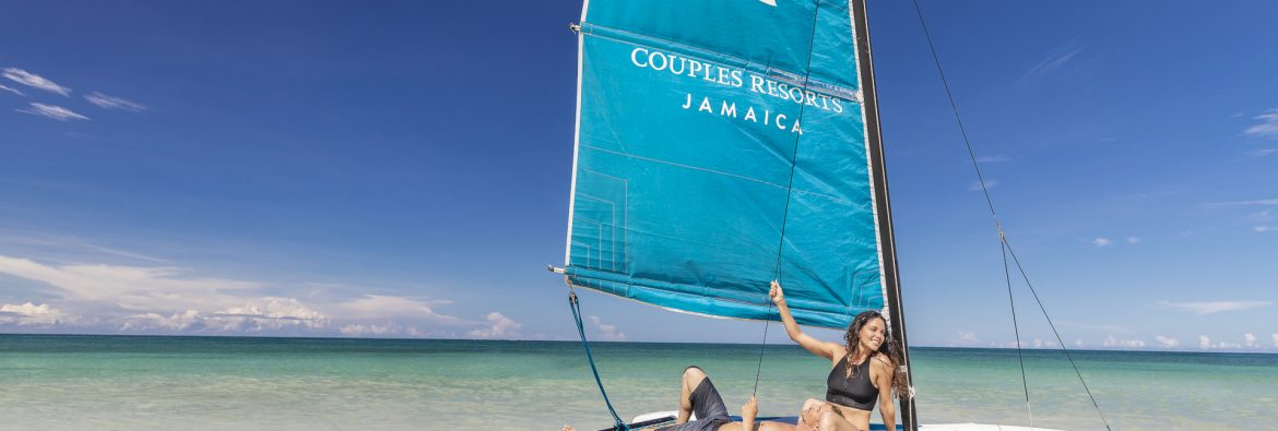 Couples Resort Jamaica, a couple on a sailboat